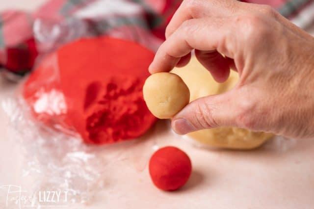 hand holding a cookie dough ball