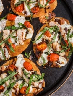 overhead view of baked chicken caprese pizzas