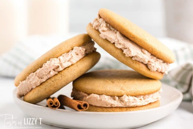 stack of three cinnamon cookie sandwiches on a plate
