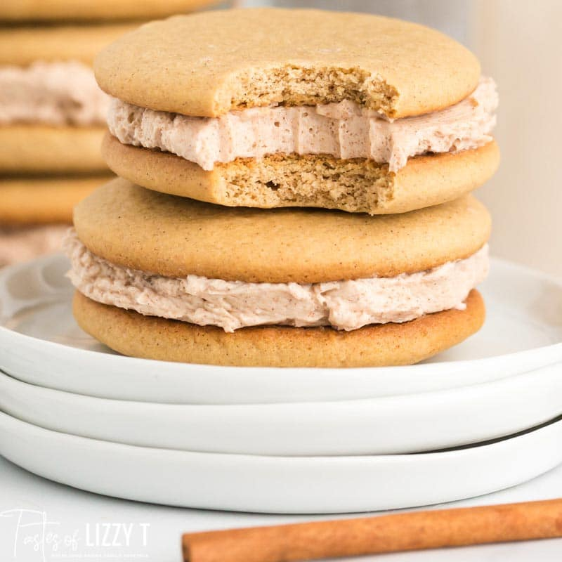 stack of cinnamon buttercream cookies with one bite out