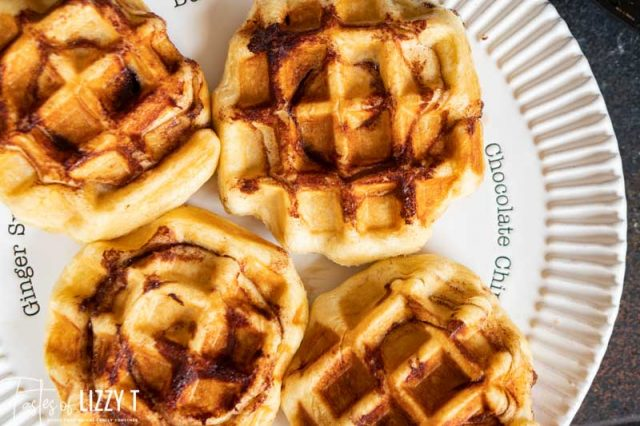 overhead view of 4 waffles on a plate