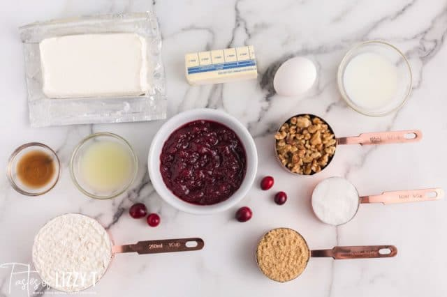 ingredients for cranberry cheesecake bars on a table