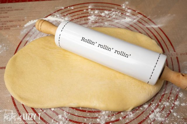 cinnamon roll dough on a pastry mat