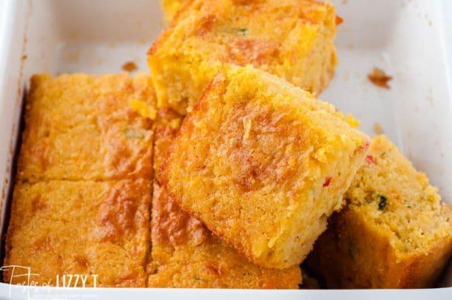 cornbread in a baking pan cut in pieces