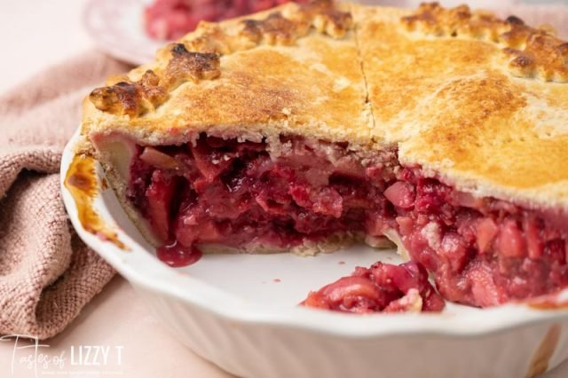 half of a cranberry pie in a pie plate