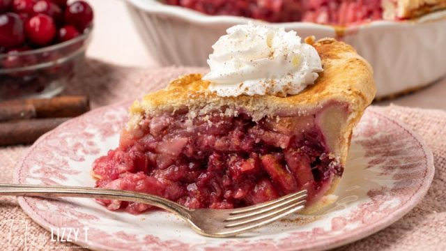 slice of cranberry pear pie on a plate with a fork