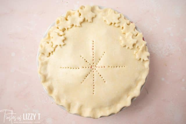 unbaked pie with leaves and star shapes