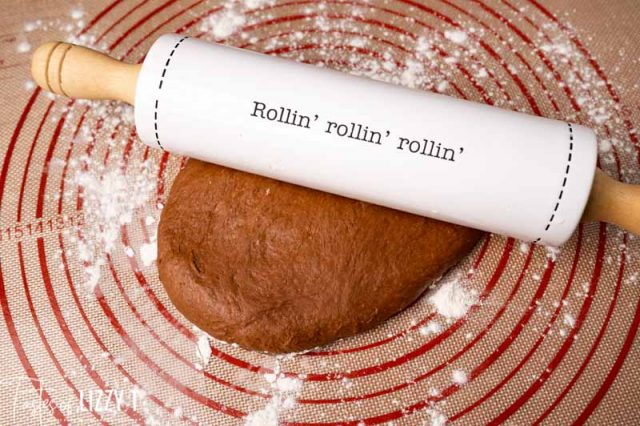 rolling pin on a mat with chocolate dough