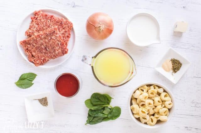ingredients for tortellini soup on a table