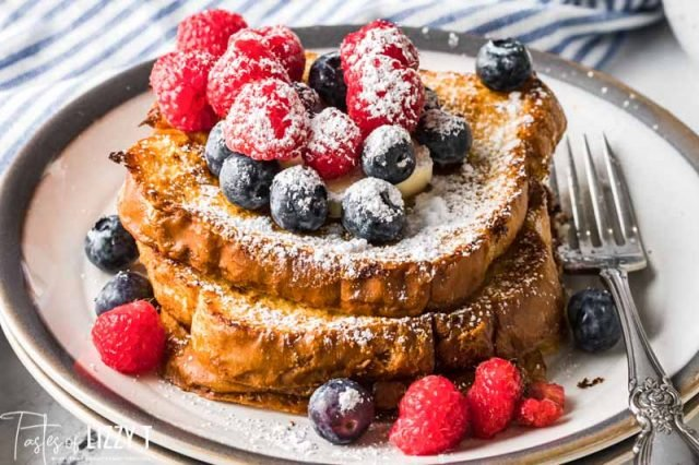 plate of french toast with berries