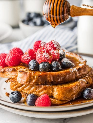 honey dripping over a stack of french toast