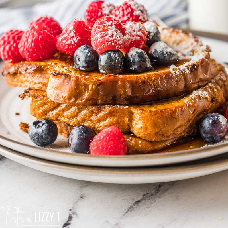 stack of french toast with fresh berries