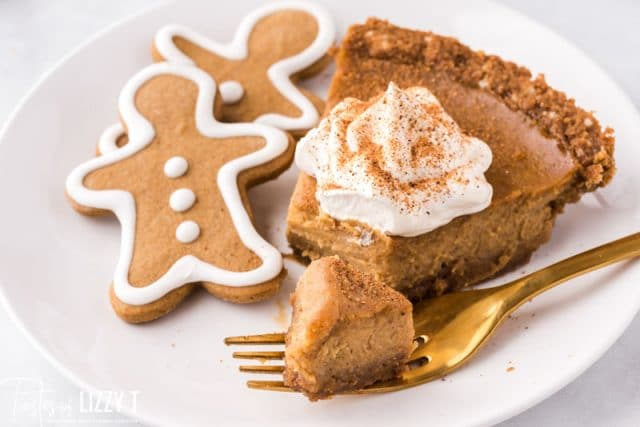 piece of pie on a plate with a fork and gingerbread