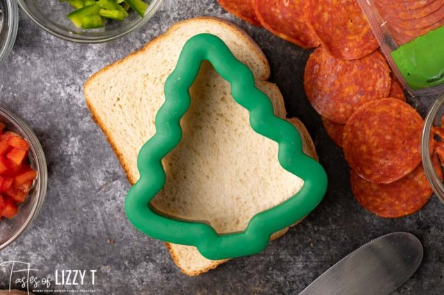 christmas tree cutout on a slice of bread