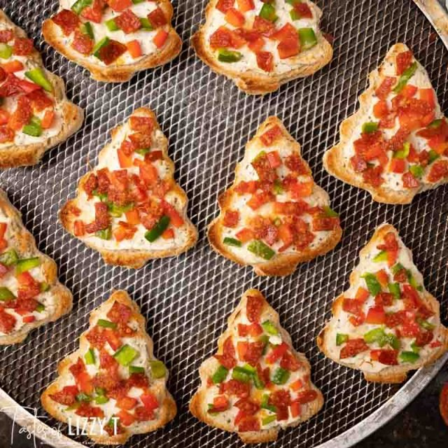 christmas tree pizzas on a baking screen
