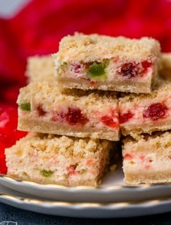 stack of merry cherry cheesecake bars on a plate