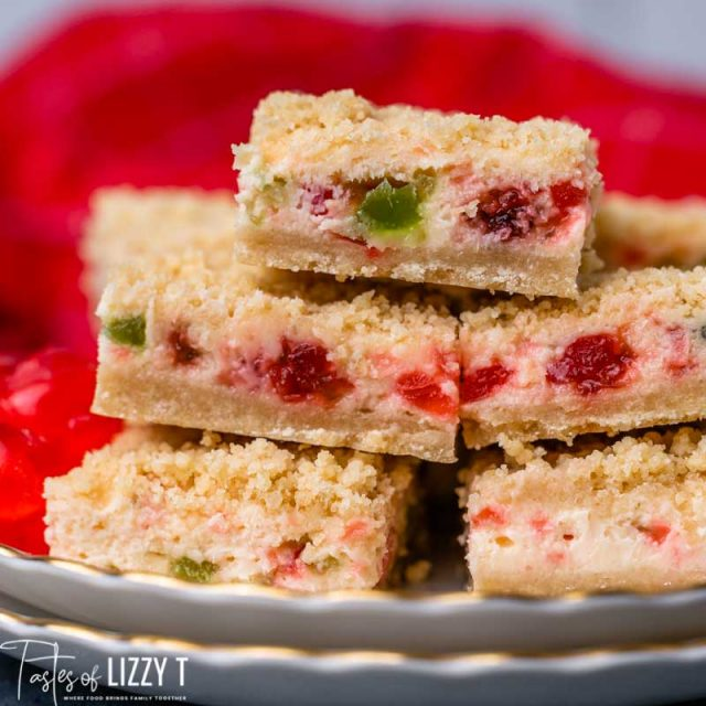 stack of christmas cheesecake bars on a plate