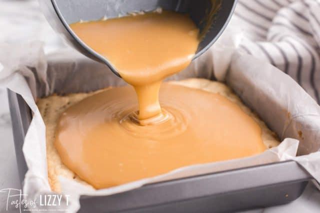 Caramel pouring over shortbread