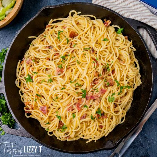 overhead view of pasta carbonara in a cast iron skillet