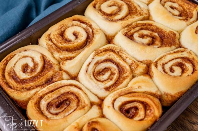 baked sourdough cinnamon rolls in a pan