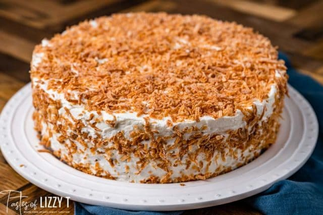 toasted coconut tres leches cake on a plate