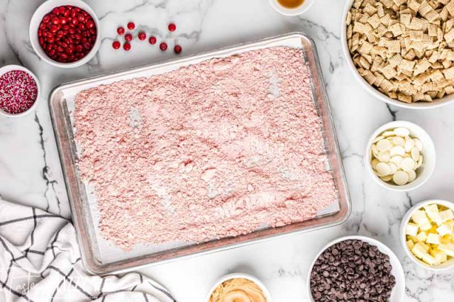 colored powdered sugar on a baking sheet