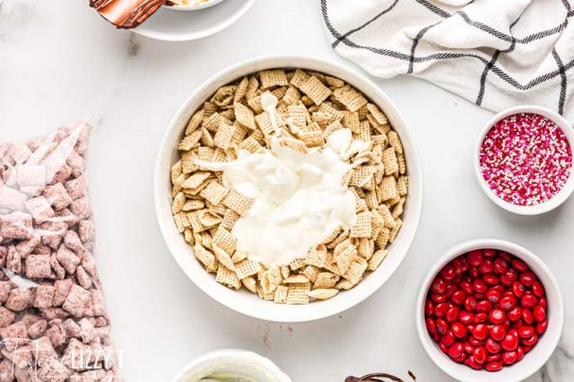 white chocolate over rice chex in a bowl