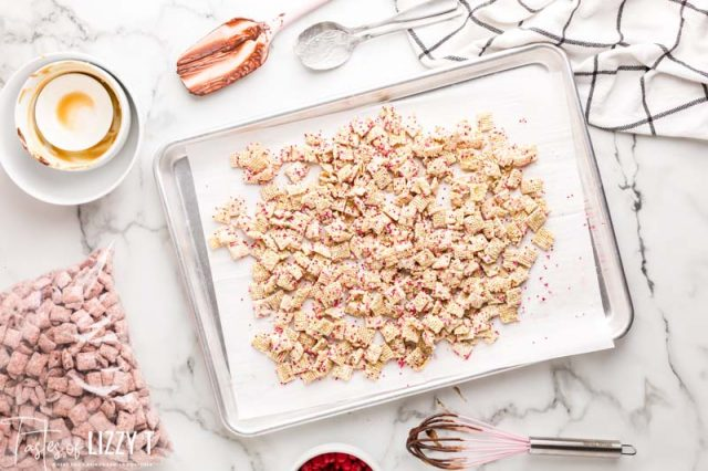 rice chex with white chocolate on a baking sheet