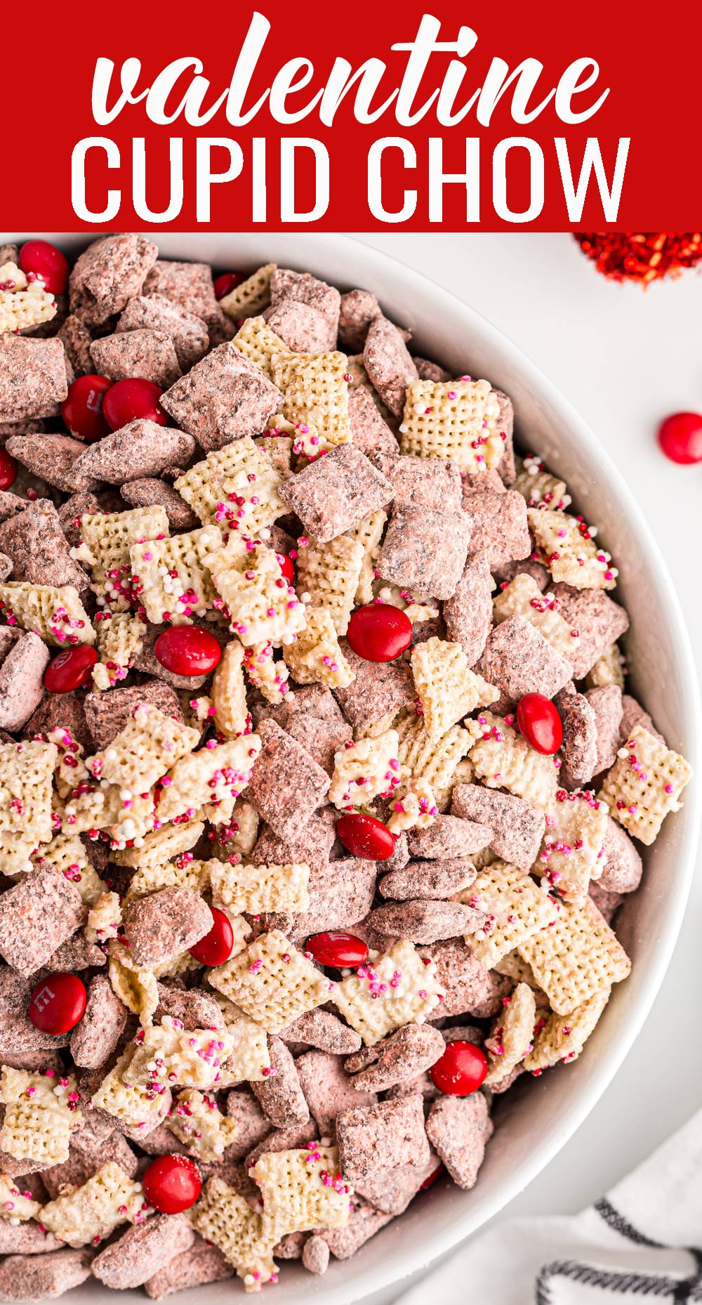 This is not your average puppy chow! Cupid's Chow is loaded with peanut butter, white chocolate and semi-sweet chocolate, sprinkles and M&M's. via @tastesoflizzyt