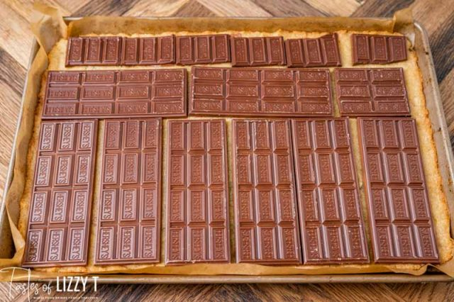 chocolate bars laying on cookies