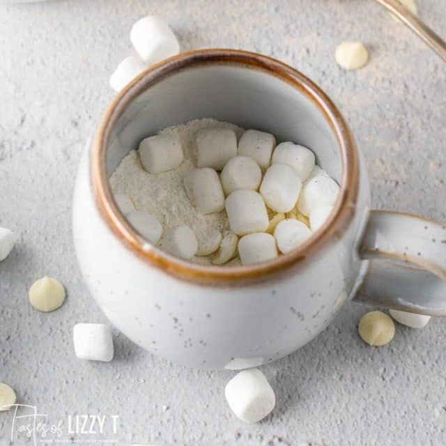 white hot chocolate powder and marshmallows in a mug