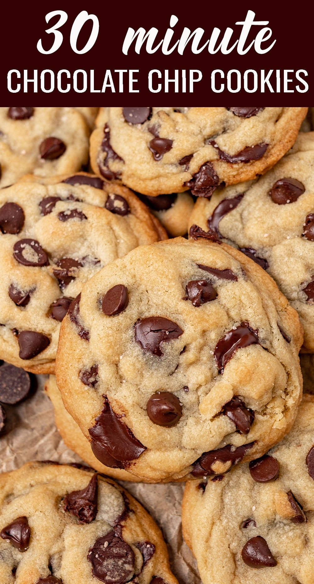 Freshly baked cookies in 30 minutes! The perfectly chewy easy chocolate chip cookies use one bowl, a spoon to mix and no dough chilling. via @tastesoflizzyt