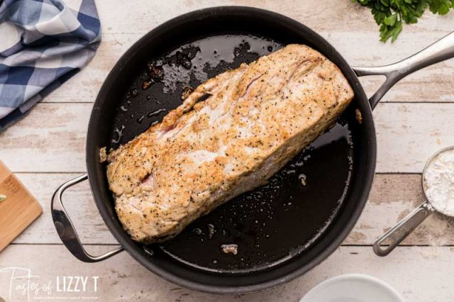 browning pork loin in a skillet