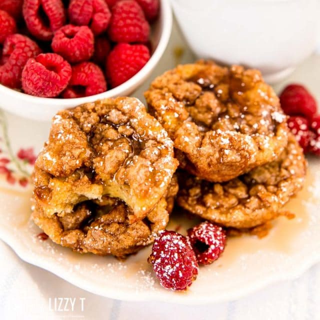 stack of french toast muffins with raspberries