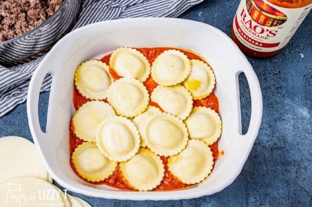 frozen ravioli in a baking pan