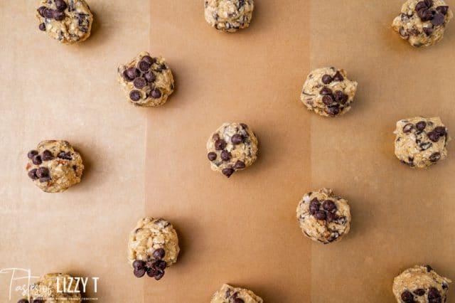 cookie dough balls on parchment paper