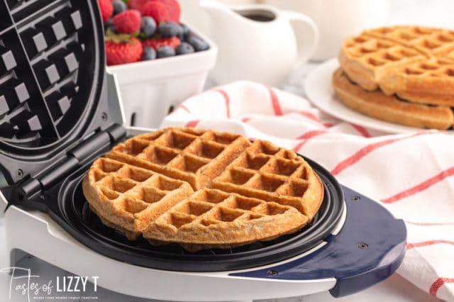 hearty whole grain waffles in a waffle iron
