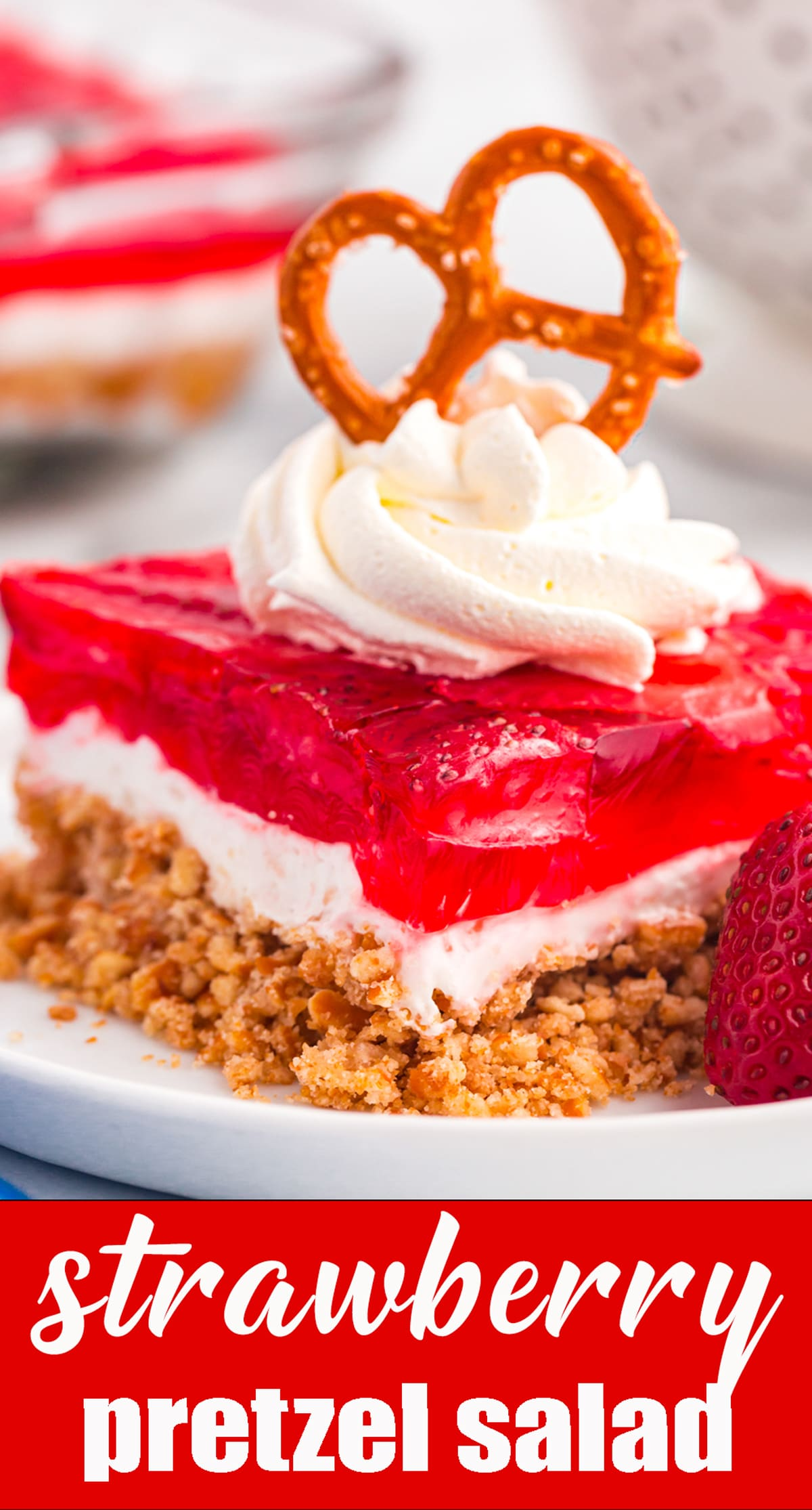 The classic summer dessert! This Strawberry Pretzel Salad recipe is the perfect combination of salty and sweet. It's a favorite at picnics and potlucks. via @tastesoflizzyt