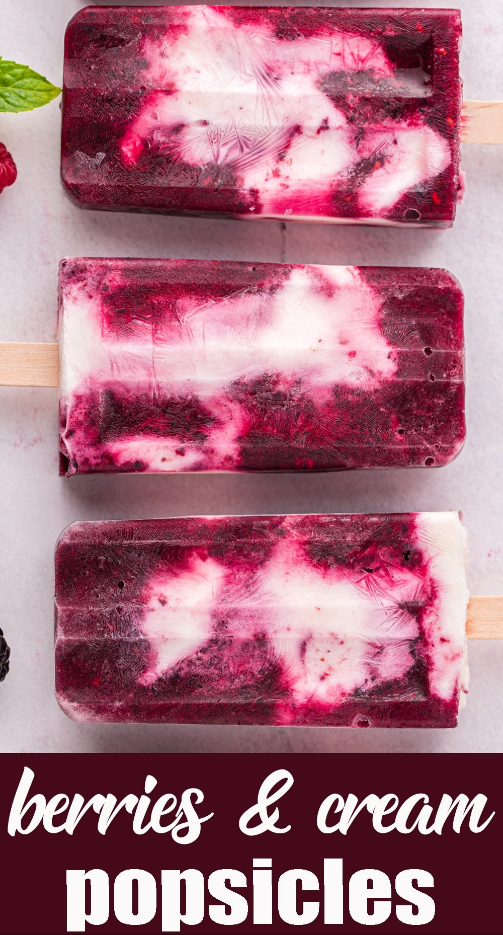 Make the hot summer days better with this delicious Berries and Cream Popsicles. With Greek yogurt, almond milk and mixed berries, these are a treat you can feel good about. via @tastesoflizzyt