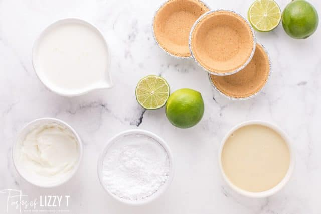 ingredients for key lime pie on a table