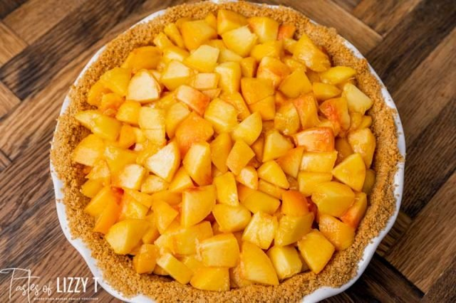 graham cracker crust filled with peaches