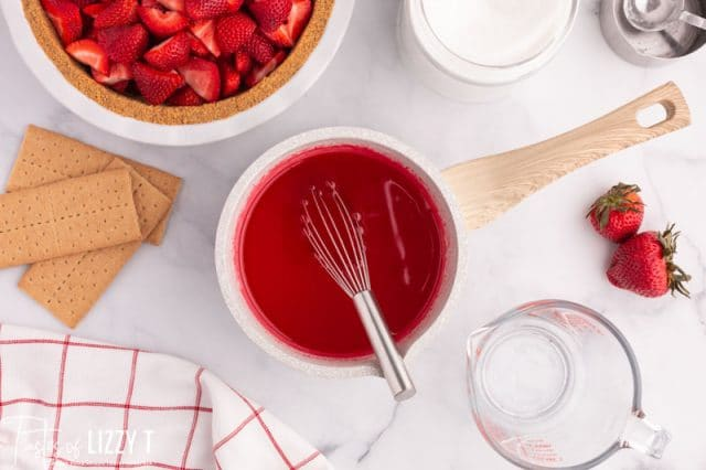 thickened strawberry jello for pie in a pan