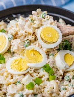 closeup of tuna macaroni salad on a serving spoon