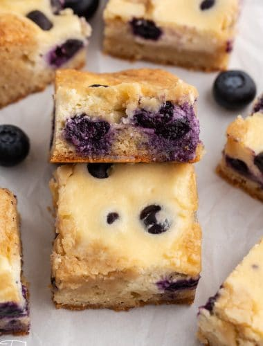 blueberry cheesecake blondies bars on a table