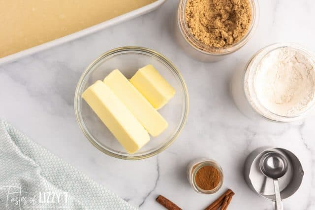 butter and sugars in bowls on a table