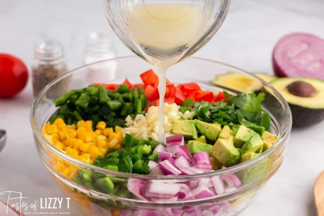 juice pouring over fresh vegetable salad
