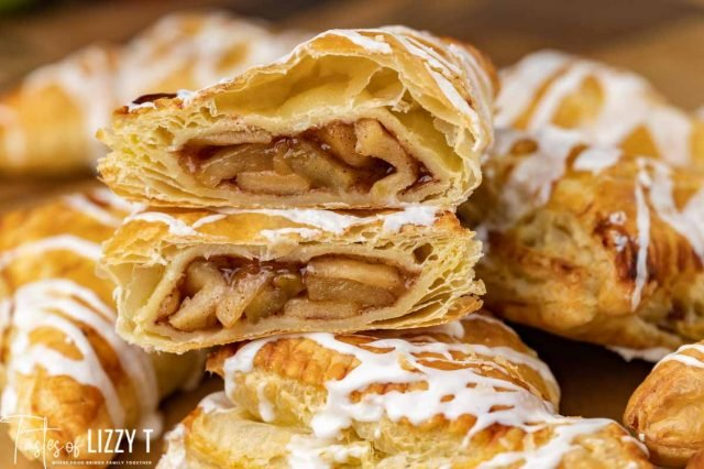 a pile of apple pastries with glaze