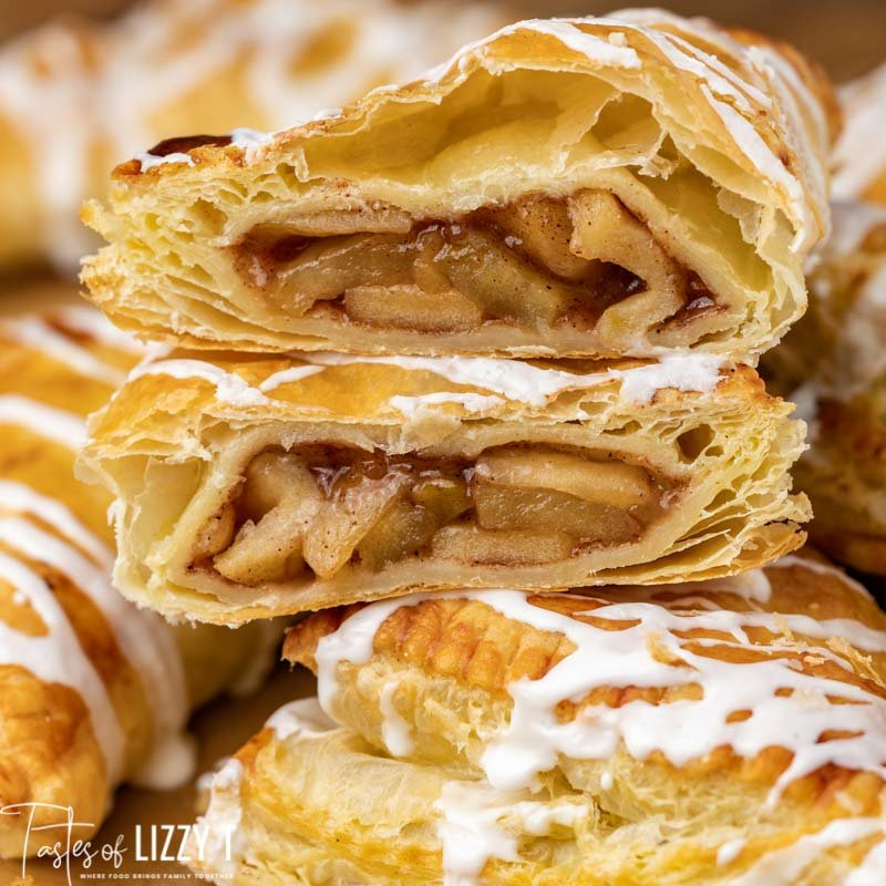 a puff pastry apple turnover sliced in half