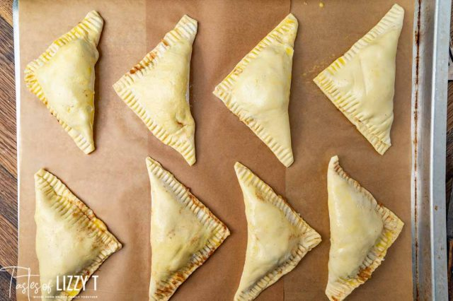 unbaked turnovers on a baking sheet
