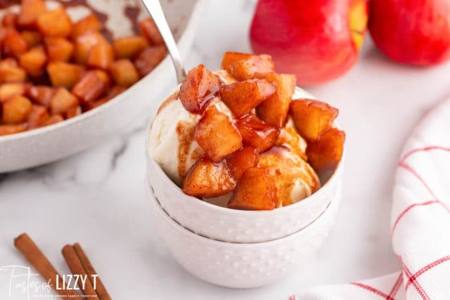 fried apples over ice cream in a bowl